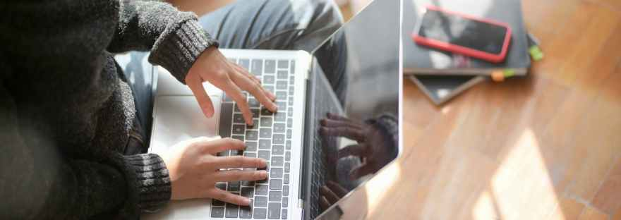 Person typing on a computer.